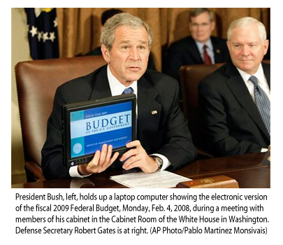 http://kickthemallout.com/images/Photos/BushHoldingLaptopBudget.jpg