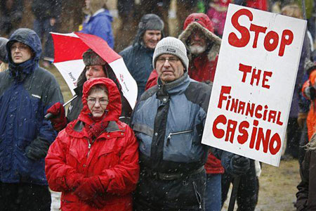 AXJ USA : WHEN WILL THE PEOPLE ARREST THE FINANCIAL CRIMINALS IN THE US? IcelandProtest